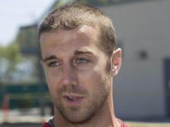 San Francisco 49ers quarterback Alex Smith (11) answers questions for the media at the 49ers practice facility on Wednesday.