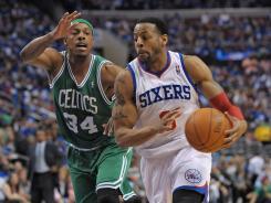 Philadelphia 76ers forward Andre Iguodala (9) drives against Boston Celtics forward Paul Pierce (34) during Game 6 on Wednesday.