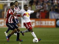 Blair Gavin, left, of the Chivas USA and Dane Richards, right, of the New York Red Bulls fight for the ball during their match. The Red Bulls remain in first place of the Eastern Conference.