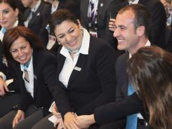 Istanbul delegates celebrate at the SportAccord conference in Quebec City on Wednesday. Istanbul, Tokyo and Madrid made the cut as the International Olympic Committee executive board trimmed the field of candidates for host of the 2020 Olympics from five cities to three.