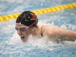 Missy Franklin competes in the 100-meter butterfly during the preliminary of the U.S. Swimming Grand Prix at the University of Minnesota Aquatic Center on Nov. 11, 2011.