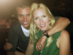 This undated photo provided by Susie Wheldon, shows Dan, left, and Susie. The widow plans to arrive Thursday night for the Indianapolis 500 and spend the weekend, accompanied by her two sons, who were present for their dad's surprise win last year, but isn't sure if she'll attend Sunday's race.