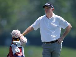 Roger Chapman of England stands in the18th fairway during the first round of the 2012 Senior PGA Championship. Chapman shot a 3-under 68.