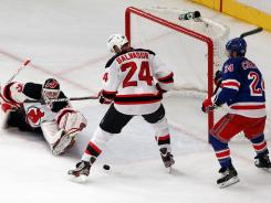 The Devils' Bryce Salvador, center, and Martin Brodeur, left, defend a Rangers shot during Wednesday's 5-3 victory. New Jersey has won two in a row.