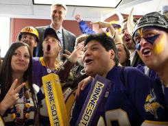 Vikings fans celebrate with Minneapolis Mayor R.T. Ryback after the the City Council voted in favor of a stadium plan.