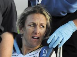 Olympic gold medalist Kristin Armstrong is consulted by medical personnel after finishing the time trial in the Exergy Tour cycling competition on Thursday in Boise, Idaho. Armstrong crashed in the race and was taken to the hospital for evaluation. She finished 11th in the time trial.