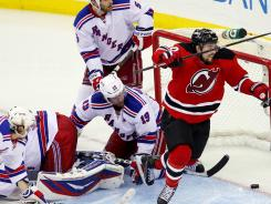 New Jersey Devils center Adam Henrique (14) celebrates his overtime goal against the New York Rangers.