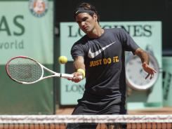 Roger Federer gets in a practice session Friday at Roland Garros.