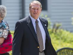 Former West Virginia football coach Don Nehlen, right, leaves the funeral service for Bill Stewart.