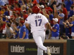 Texas Rangers right fielder Nelson Cruz rounds the bases after hitting a grand slam against the Toronto Blue Jays on Friday night.