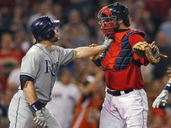 The Rays' Luke Scott gets into it with Red Sox catcher Jarrod Saltalamacchia as benches clear after Scott was hit by a pitch in the ninth inning.