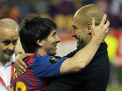 Barcelona's Lionel Messi, left, celebrates the victory with his manager Josep Guardiola, in what was his final match managing Messi and Barcelona.