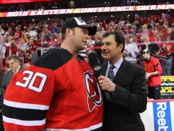 Goalie Martin Brodeur chats with the NHL Network's Joe Micheletti after the Devils eliminated the Rangers Friday in Game 6 of the Eastern Conference final.