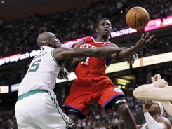Game 7 between the Boston Celtics and Philadelphia 76ers was dominated by the defenses, as Boston's Kevin Garnett, left, shows by cutting off Philadelphia point guard Jrue Holiday.