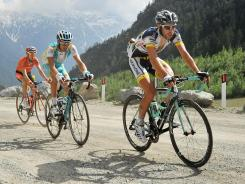 Belgium's Thomas De Gendt, right, leads a pack of riders through the steep Passo dello Stelvio during the 20th stage of the Giro d'Italia on Saturday.