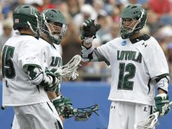 Loyola's Eric Lusby celebrates one of his five goals against Notre Dame as the Greyhounds advanced to the title game.