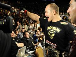 Junior Dos Santos celebrates his successful title defense at UFC 146.