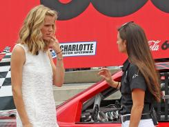 "Danica Patrick, right, talks with actress and model Brooklyn Decker about pit stops before the Coca-Cola 600 at Charlotte Motor Speedway. Decker was there to promote her movie, ""Battleship."""