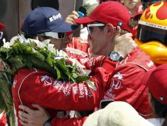 Dario Franchitti, left, greets teammate Scott Dixon after the Indy 500. Both Ganassi drivers were close friends with the late Dan Wheldon.