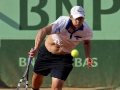The struggles continue for the USA's Andy Roddick, who lost his first-round match Sunday to Nicolas Mahut of France 6-3, 6-3, 4-6, 6-2.