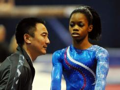 Gabrielle Douglas, right, talks to coach Liang Chow on Saturday.