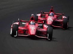 Scott Dixon, front, and Dario Franchitti run 1-2 during the Indianapolis 500. Franchitti's win was the first for Honda this year in the Izod IndyCar Series.