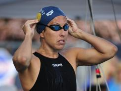 In this file photo from April 20, Janet Evans prepares to swim the 400-meter freestyle during the Fran Crippen Memorial Swim Meet Of Champions in Mission Viejo, Calif.