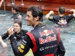 Red Bull driver Mark Webber celebrates after winning the Monaco Grand Prix. Team members and team principal Christian Horner jumped into the pool of their motor home after the win.