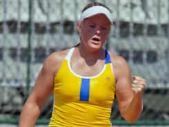 Melanie Oudin of the USA raps a forehand during her victory Sunday against Johanna Larsson of Sweden to move into Round 2 at the French Open.
