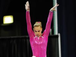 Rebecca Bross competes on the balance beam during the Secret U.S. Classic on Saturday in Chicago.