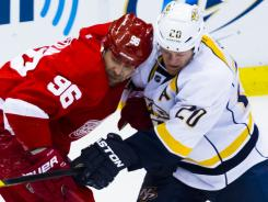 The Red Wings are expected to pursue defenseman Ryan Suter, right, and have a decision to make on Tomas Holmstrom.