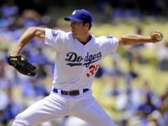 Dodgers pitcher Chris Capuano improved to 7-1 on the season after allowing two hits in seven innings Sunday against the Astros.