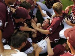 Members of the Mississippi State baseball team celebrate after winning the Southeastern Conference tournament championship in Hoover, Ala.