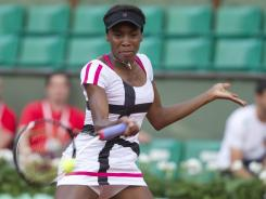 Venus Williams of the USA wins her first match in a Grand Slam event since withdrawing from the U.S. Open in September. She rallied to defeat Paula Ormaechea of Argentina 4-6, 6-1, 6-3.