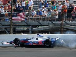 Marco Andretti crashes with 12 laps to go in the Indianapolis 500.