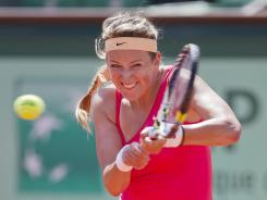 Top-ranked Victoria Azarenka of Belarus survived a scare Monday in her first-round match at the French Open, winning 12 of the last 14 games to beat Alberta Brianti of Italy 6-7 (6-8), 6-4, 6-2.
