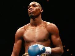 Paul Williams, shown during a middleweight fight against Winky Wright in 2009, has been paralyzed from the waist down after being involved in a motorcycle crash on Sunday.