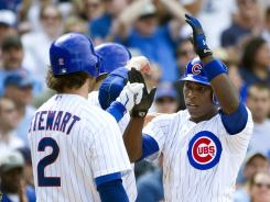 Alfonso Soriano, right, went 3-for-4 with three RBI against the Padres. He is second on the Cubs with 27 RBI for the season.
