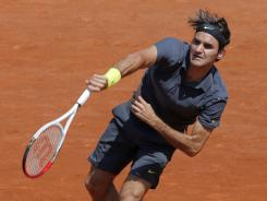 Roger Federer of Switzerland serves up a 6-2, 7-5, 6-3 victory Monday against Tobias Kamke of Germany in Round 1 of the French Open.