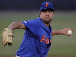 Florida's Brian Johnson pitches in the third inning against South Carolina during the Southeastern Conference tournament.