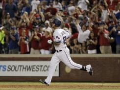 Mike Napoli rounds first base after hitting a three-run homer in the sixth inning for the Rangers. In his last two games, Napoli is 3-for-6 with two home runs, four runs and five RBI.