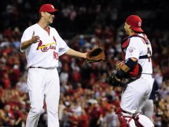 Cardinals pitcher Adam Wainwright, left, celebrates with catcher Yadier Molina after shutting out the San Diego Padres on May 22.