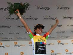 Evelyn Stevens salutes the crowd after claiming the overall win at the Exergy Tour in Boise. Stevens won $10,000 with the victory.