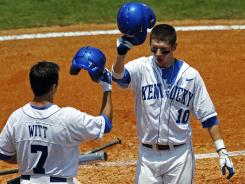 Kentucky's J.T. Riddle (10) is congratulated by Lucas Witt after hitting a home run during the SEC tournament.