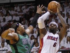 Paul Pierce, left, can't quite block the shot of LeBron James in Game 1 of the Eastern Conference finals.