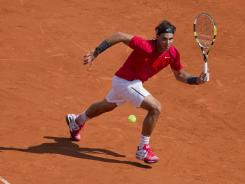 Rafael Nadal of Spain chases down a forehand during his 6-2, 6-2, 6-1 victory against Simone Bolelli of Italy.