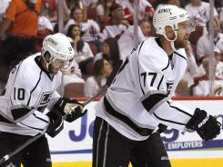 Los Angeles' Jeff Carter (77) joined the Kings and former teammate Mike Richards (10) near the trade deadline.