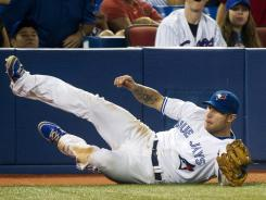 Blue Jays third baseman Brett Lawrie makes a diving catch against the Orioles during the ninth inning of Toronto's 8-6 victory Tuesday.