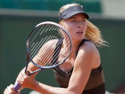 Maria Sharapova of Russia chases down a return Tuesday during her 6-0, 6-0, first-round victory against Alexandra Cadantu of Romania.