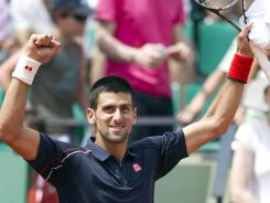Novak Djokovic of Serbia celebrates his 6-0, 6-4, 6-4 victory Wednesday against Blaz Kavcik of Slovenia in the second round of the French Open.